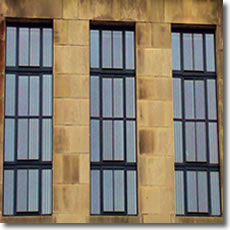 Windows set in Sandstone